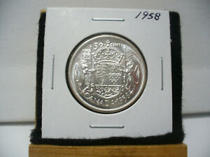 Click now to see the BUY IT NOW Price! 1958  CANADA  SILVER  HALF  DOLLAR  50 CENT PIECE   58    NICE   GRADE