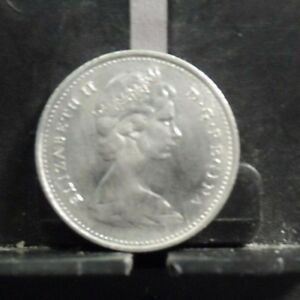 CIRCULATED 1969 10 CENTS CANADIAN COIN 10619 R1 ..FREE DOMESTIC SHIPPING