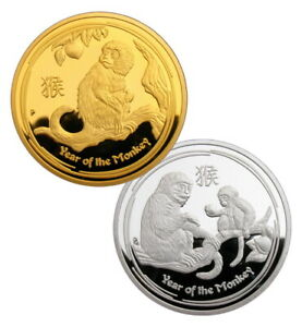 A PAIR OF 2016 YEAR OF THE MONKEY LUNAR ZODIAC COMMEMORATIVE COINS COLLECTIBLES