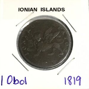 Click now to see the BUY IT NOW Price! 1819 IONIAN ISLANDS GREECE 1 OBOL  KM 32    NICE ALL ORIGINAL 200 Y/O COIN