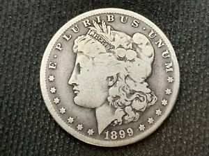 1899 O  MORGAN DOLLAR   VG F      3 OR MORE   FREE S/H       90  SILVER    C1136