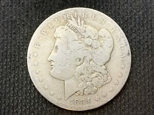 1884 O  MORGAN DOLLAR   VG F       3 OR MORE   FREE S/H      90  SILVER    C1129