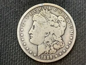 1889 O  MORGAN DOLLAR   F VF       3 OR MORE   FREE S/H      90  SILVER    C1121