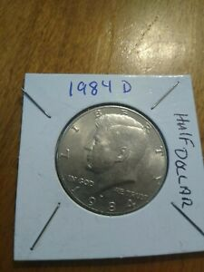 1984 D UNITED STATES KENNEDY HALF DOLLAR  COIN  THE D IS OFF CENTER
