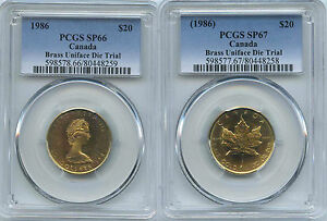 Click now to see the BUY IT NOW Price! UNIQUE PAIR OF 1986 CANADA  OZ MAPLE LEAF $20 BRASS DIE TRIALS PCGS SPECIMEN