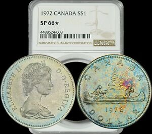 Click now to see the BUY IT NOW Price! 1972 CANADA ELIZABETH II SILVER DOLLAR NGC SP66 STAR  BEAUTIFUL COLOR TONED GEM