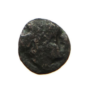 GREECE ANCIENT AE TINE HEAD 0.6G  T56 561