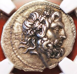 Click now to see the BUY IT NOW Price! C.238 BC EPIROTE REPUBLIC NGC XF AFTER  AR DRACHM ZEUS RV FENIKS IN OAK WREATH