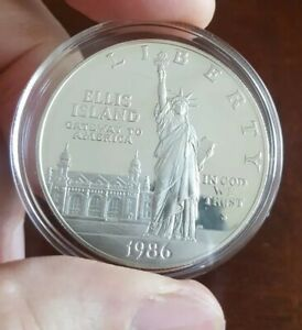 1986 S ELLIS ISLAND PROOF SILVER 90  ONE DOLLAR COIN IN AIRTITE PLASTIC CASE.