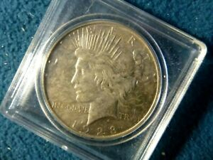 1923 PEACE DOLLAR IN AU CONDITION IN CASING