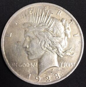 1923 PEACE SILVER DOLLAR IN XF  CONDITION NICELY TONED SILVER PEACE DOLLAR