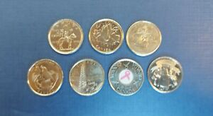 A COLLECTION OF 7 CIRCULATED CANADIAN COMMEMORATIVE QUARTERS  VARIOUS YEARS