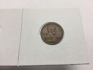 1929 STRUCK THRU LAMINATION WHEAT CENT LY FINE/ALMOST UNCIRCULATED