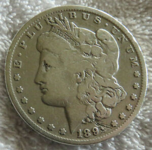 1891 CC MORGAN SILVER DOLLAR GOOD WITH SCRATCHED 1 IN DATE CARSON CITY