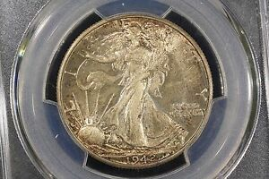 Click now to see the BUY IT NOW Price! 1942 GEM TONED WALKER PCGS MS 65