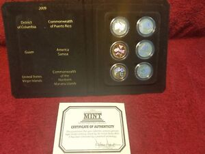 Click now to see the BUY IT NOW Price! 2009 DC & US TERRITORIES QUARTERS ENHANCED 6 COIN SET W/ CAPSULES