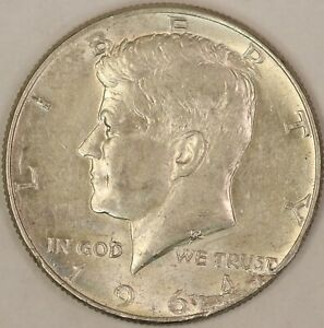 1964 KENNEDY HALF DOLLAR. DETACHED LAMINATION ERROR. RAW584/JL