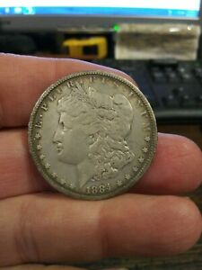 1884 O MORGAN SILVER DOLLAR AS FOUND IN ESTATE CLEAN OUT. NICE
