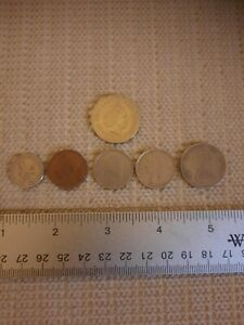 ODD LOT OF 12 FOREIGN COINS OR TOKENS  OL2