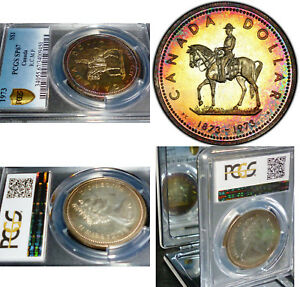 Click now to see the BUY IT NOW Price! RAINBOW TONED SILVER COIN 1973 CANADA MOUNTED HORSE DOLLAR  PCGS SP67