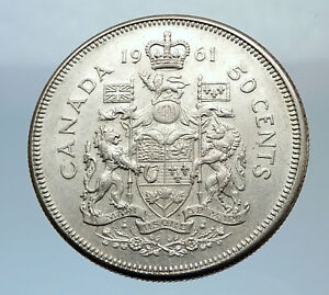 Click now to see the BUY IT NOW Price! 1961 CANADA QUEEN ELIZABETH II SILVER 50 CENT VINTAGE ARMS SILVER COIN   I71638
