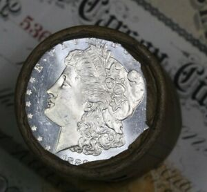 Click now to see the BUY IT NOW Price! 1889 DMPL & CC CARSON CITY ENDS ON THIS SHOTGUN ROLL OF MORGAN SILVER DOLLARS BU