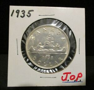 Click now to see the BUY IT NOW Price!  TYPE II 1935 CANADA SILVER DOLLAR   COUNTERSTAMPED J.O.P.       ENN COINS