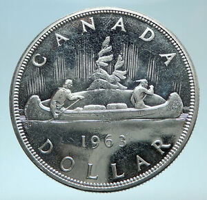 Click now to see the BUY IT NOW Price! 1963 CANADA W UK QUEEN ELIZABETH II VOYAGERS GENUINE SILVER DOLLAR COIN I78614