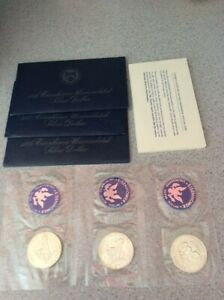 3   UNCIRCULATED COINS  1972S 1973S1974S EISENHOWER SILVER DOLLAR W/ ENVELOPE