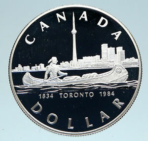 Click now to see the BUY IT NOW Price! 1984 CANADA UK QUEEN ELIZABETH II CANOE IN TORONTO 150Y PROOF SILVER COIN I83116