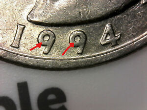 1994 D WASHINGTON QUARTER WITH DIE CHIP ON INSIDE OF
