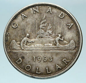 Click now to see the BUY IT NOW Price! 1963 CANADA W UK QUEEN ELIZABETH II VOYAGERS GENUINE SILVER DOLLAR COIN I84071