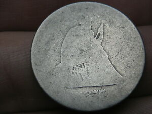 1877 S SILVER SEATED LIBERTY QUARTER  LOWBALL HEAVILY WORN PO1 CANDIDATE?