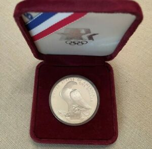 1984 LOS ANGELES OLYMPICS UNITED STATES OF AMERICA ONE DOLLAR COIN ENCASED BOXED