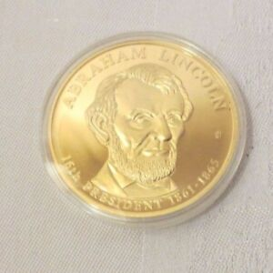 ABRAHAM LINCOLN DOLLAR TRIAL COMMEMORATIVE COIN AMERICAN MINT NEW