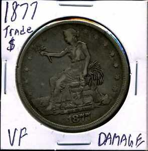 1877 $1 SILVER TRADE DOLLAR WITH VF DETAILS DAMAGED