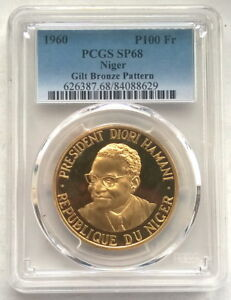 Click now to see the BUY IT NOW Price! NIGER 1960 DIORI HAMANI 100 FR PCGS SP68 GOLD PLATED PATTERN COIN VERY