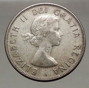 Click now to see the BUY IT NOW Price! 1958 CANADA UNDER QUEEN ELIZABETH II SILVER 50 CENTS CANADIAN COIN ARMS I56633