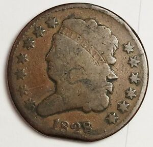 1828 HALF CENT.  ERROR.  MINT CLIPPED PLANCHET.  CIRCULATED.  V.G.  114267