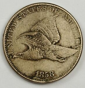 1858 FLYING EAGLE.  ERROR.  DIE BREAK UNDER DATE.  NATURAL X.F.  129479