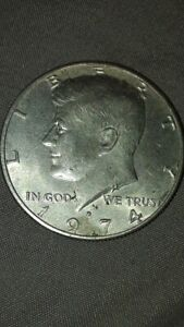 1974 JFK 50 CENT ERROR COIN WITH MULTIPLE 4S ON NECK AND DOUBLING