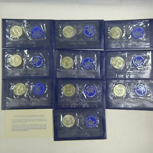 LOT OF  10  1973 S SILVER UNCIRCULATED EISENHOWER DOLLARS. BU BLUE IKES