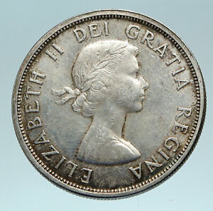 Click now to see the BUY IT NOW Price! 1963 CANADA W UK QUEEN ELIZABETH II VOYAGERS GENUINE SILVER DOLLAR COIN I84163