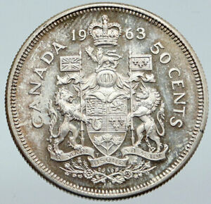 Click now to see the BUY IT NOW Price! 1963 CANADA QUEEN ELIZABETH II ARMS OLD VINTAGE LION SILVER 50 CENTS COIN I86115