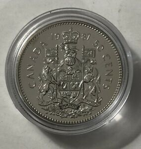 1987 CANADA 50 CENTS PROOF LIKE IN HOLDER.