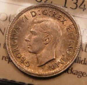 1938 CANADA SILVER 10 CENTS ICCS AU 58. NICELY TONED.