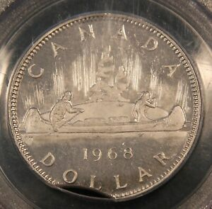 Click now to see the BUY IT NOW Price! 1968 CANADA $1 DOLLAR ERROR CLIPPED PLANCHET. PCGS MS63. .