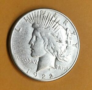 1922 S  PEACE DOLLAR IN FAIR CONDITION WITH 3   1964 SILVER QUARTERS    1P