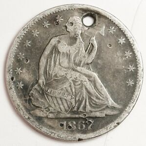 1867 S SEATED LIBERTY HALF.  V.F. DETAIL.  HOLED.  120439