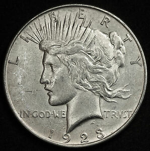 1923 D PEACE SILVER DOLLAR. ERROR. PLANCHET OR DIE CHIP IN FEATHER. X.F. 92865